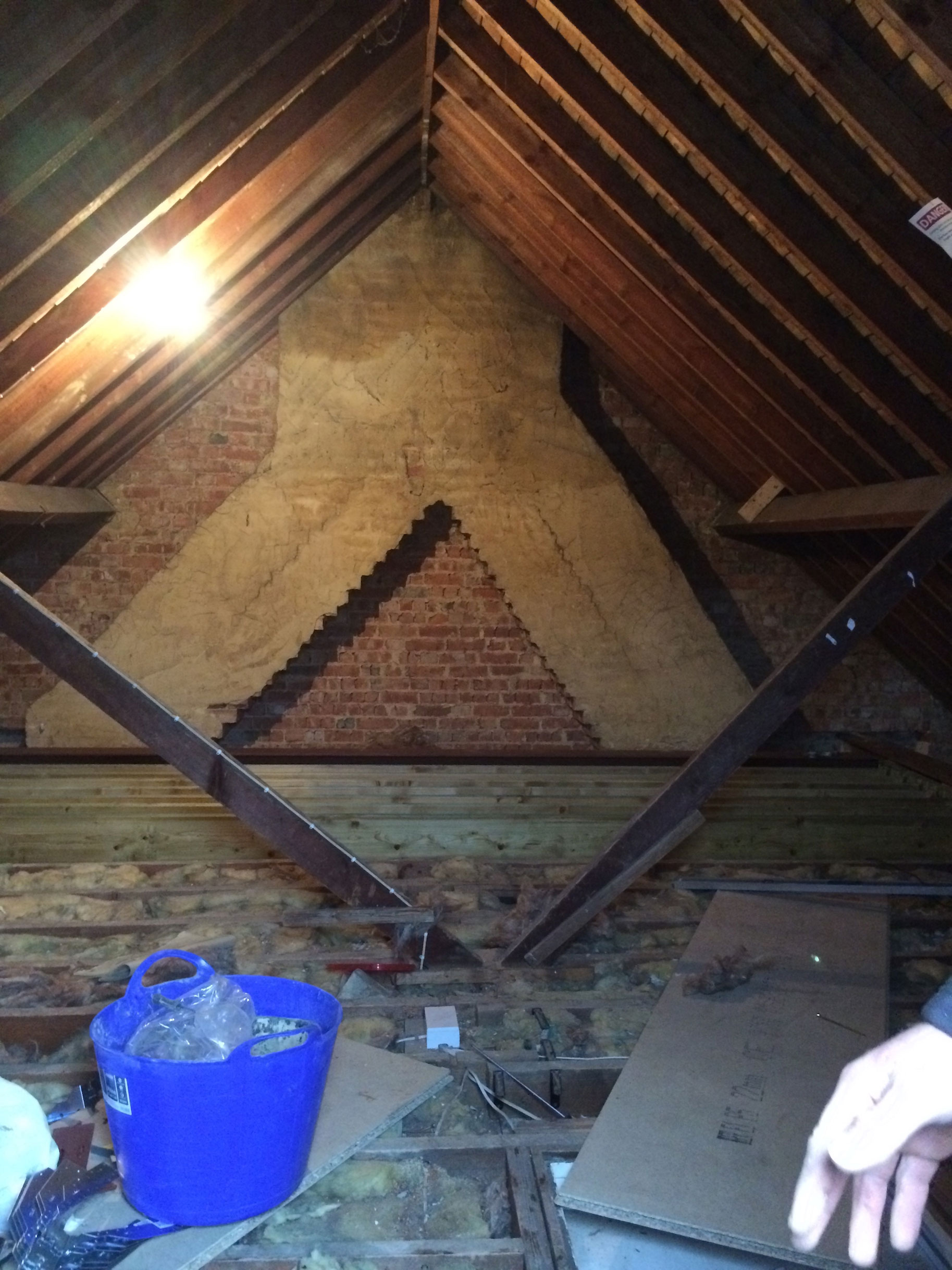 Within The Attic There Was A Double Converging Chimney And