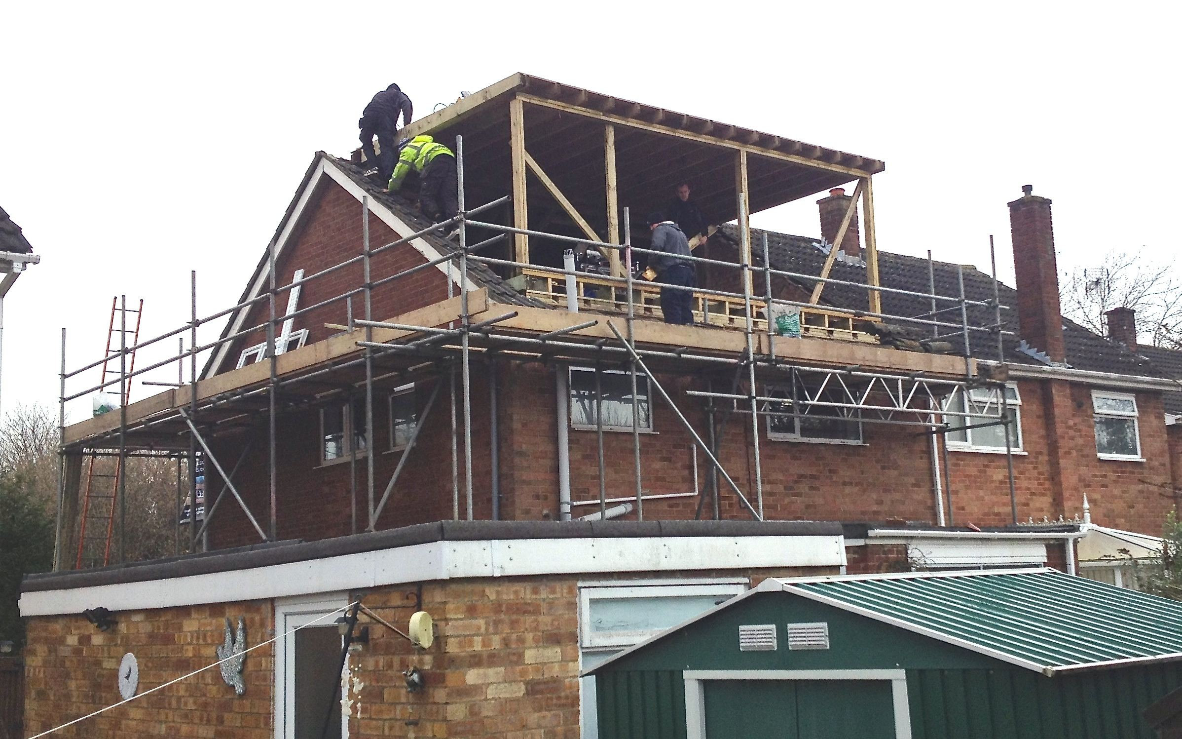 Rear dormer loft conversion skylofts for Cost of building a roof